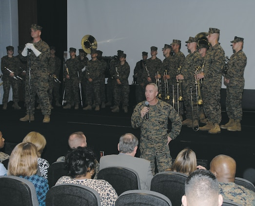 Maj. Gen. Charles L. Hudson, commanding general, Marine Corps Logistics Command, bids farewell to the Albany Marine Band during its deactivation ceremony at the Base Theater, Feb. 24.