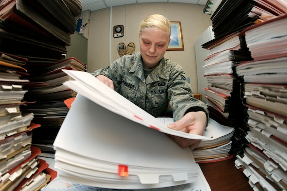 U.S. Air Force Senior Airman Jacqueline Bongard, 354th Contracting Squadron contracting specialist, performs a contract file review Feb. 29, 2012, Eielson Air Force Base, Alaska. Bongard ensures base contractors are paid an agreed amount according to their respective contracts. (U.S. Air Force photo/Staff Sgt. Jim Araos)