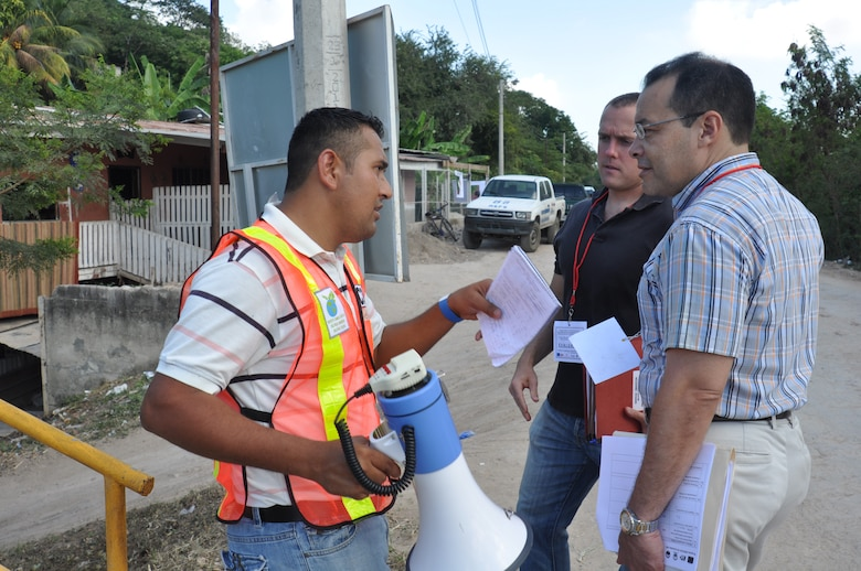 SAN PEDRO SULA, Honduras - Dr. Ricardo Aviles, a Medical Officer at the Medical Element, and Capt. Tyler Grunewald, the deputy director of MEDEL operations setion, speak with a community member about the COPECO exercise here last month. Joint Task Force-Bravo, Soto Cano Air Base, Honduras, sent members of the Central America Survey Assessment Team to serve as evaluators during a two-day Foreign Humanitarian Assistance and Disaster Relief preparedness exercise in the San Pedro Sula valley last month. (U.S. Air Force photo/Capt. Candice Allen)