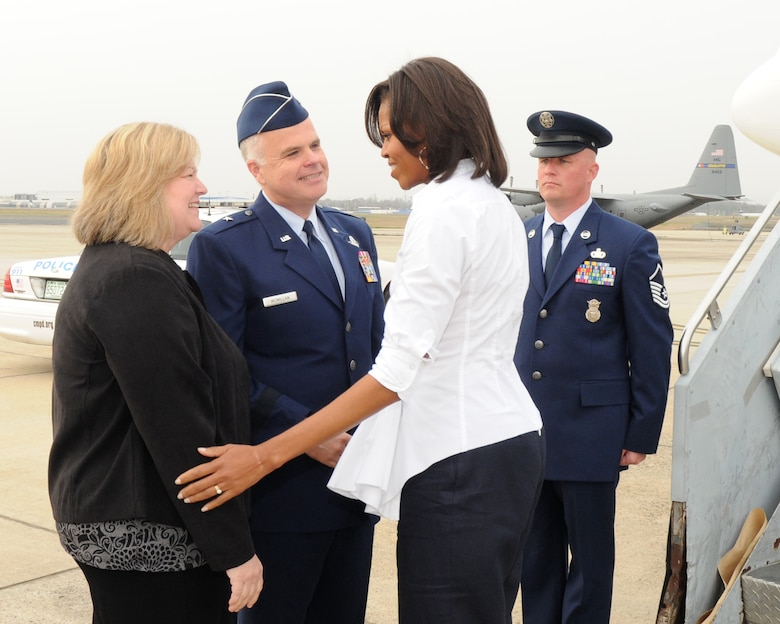 First Lady Michelle Obama is welcomed by Brig. Gen. Tony E. McMillan, 145th Airlift Wing Commander and wife Vickie upon arrival at the  North Carolina Air National Guard Base Charlotte,  N.C.,  March 2, 2012.(Photo by Tech. Sgt. Patricia Findley, 145th AW Public Affairs)