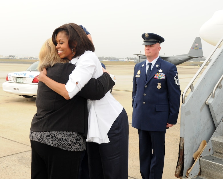 First Lady Michelle Obama hugs  Vickie McMillan wife of  Brig. Gen. Tony E. McMillan, commander of the 145th Airlift Wing, North Carolina Air National Guard upon her  arrival at the  North Carolina Air National Guard Base in Charlotte,  N.C.,  March 2, 2012. (Photo by Tech. Sgt. Patricia Findley, 145th AW Public Affairs)