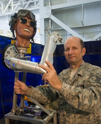 Tech. Sgt. Daniel Glessner, 459thMaintenance Squadron machinist, shows skeletal structure of motorized mannequin, named after his son, Brian during some recent upgrades.  (Photo/Bobby Jones)