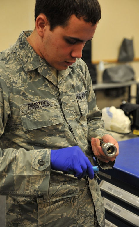U.S. Air Force Senior Airman Joshua Blankenship, 366th Operations Support Squadron aircrew flight equipment technician, sands a mortar tube that is placed in the kit for the aircrew parachutes Feb. 29, 2012, at Mountain Home Air Force Base, Idaho. The mortar tube is filled with explosive powder that pushes the parachute out of the pack when it is released. (U.S. Air Force photo by Airman 1st Class Heather Hayward/Released)
