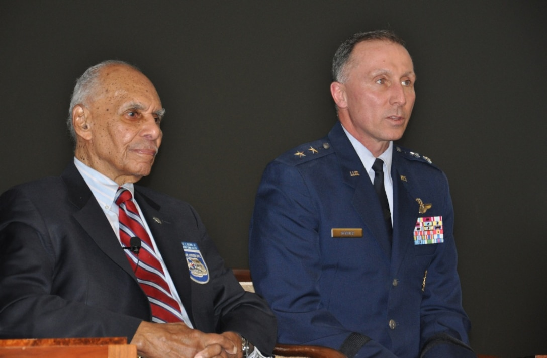 JOINT BASE McGUIRE-DIX-LAKEHURST, N.J.— Maj. Gen. Bill Bender, U.S. Air Force Expeditionary Center commander, and Dr. Roscoe Brown Jr., a Tuskegee Airman and former commander of the 100th Fighter Squadron during World War II, participate in a panel discussion about diversity in the Air Force at the U.S. Trust building in New York City, Feb. 28. The event was hosted by the Bank of America Black Professionals Group with an audience comprised of over 100 business professionals from the New York area. (Photo by U.S. Air Force 1st Lt. Sybil Taunton, USAF Expeditionary Center Public Affairs)