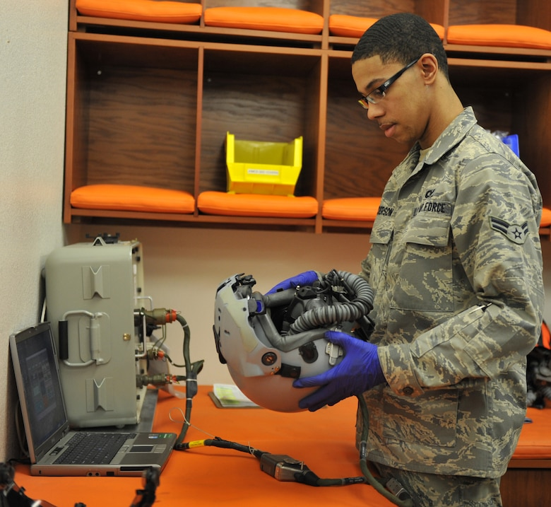 U.S. Air Force Airman 1st Class Albert Anderson, 366th Operations Support Squadron aircrew flight equipment apprentice, checks a pilot's helmet Feb. 27, 2012, at Mountain Home Air Force Base, Idaho. The equipment technicians perform pre- flight, post-flight and 30 day safety checks of the helmets. (U.S. Air Force photo by Airman 1st Class Heather Hayward/Released)