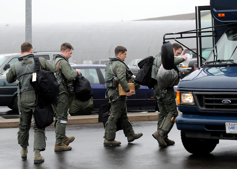 SPANGDAHLEM AIR BASE, Germany -- Pilots from the 480th Fighter Squadron here board a bus headed toward a staging area for the squadron's F-16 Fighting Falcon aircraft March 2 before departing for Anatolian Falcon 2012. AF12 is a weapons-training deployment geared to expanding and honing military interoperability between the U.S. and Turkish air forces. More than 250 Airmen and 15 aircraft will participate in the exercise, which involves air missions to include interdiction, attack, air superiority, defense suppression, airlift, air refueling and reconnaissance. (U.S. Air Force photo by Staff Sgt. Daryl Knee/Released)