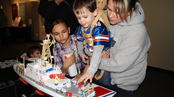 ST. LOUIS, Mo. — Children explore a model of a U.S. Coast Guard vessel as they learn about river navigation Feb. 25 during Engineer Week at the St. Louis Science Center.
