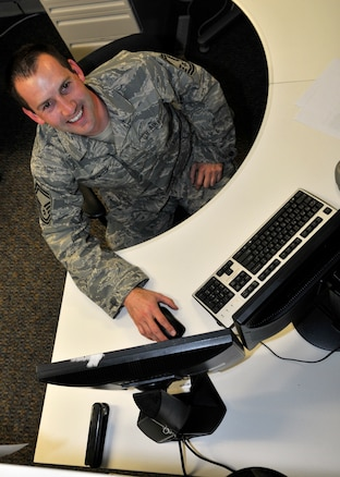 U.S. Air Force Senior Master Sgt. Cody Mosher analyzes client systems for quality assurance from his desk from the Utah Air National Guard Base in Salt Lake City Utah, 3 Mar 2012. (U.S. Air Force Phot by Tech. Sgt. Jeremy Giacoletto-Stegall/Released)