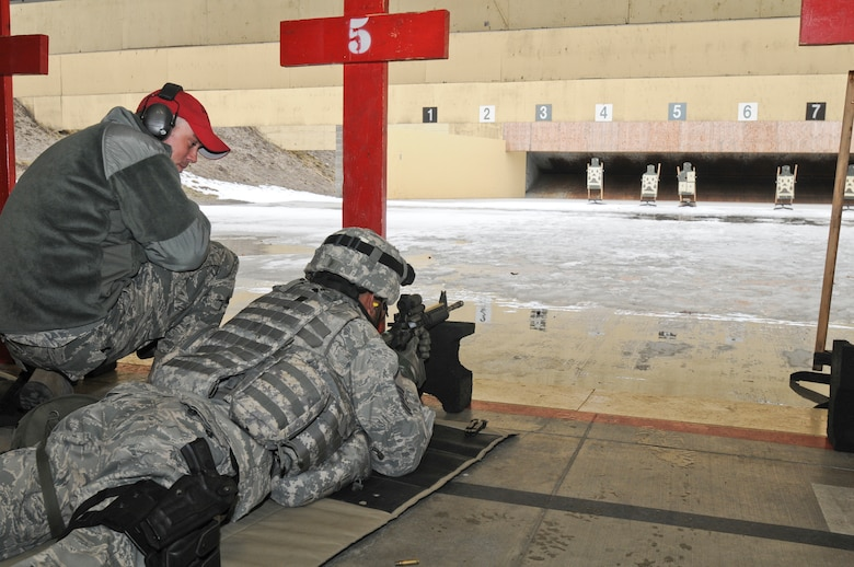 Staff Sgt. Lonnie Bell II instructs Master Sgt. Joseph Fields, both from the 141st Security Forces Squadron, during weapons qualification training at Fairchild Air Force Base, Wash. on March 3, 2012. (U.S. Air Force photo by Master Sgt. Mindy Gagne)