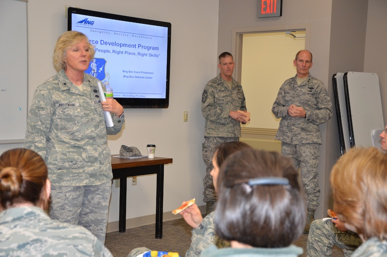 Brig. Gen. Carol Protzmann speaks to a group of company grade officers Jan. 8, 2012 at Pease Air National Guard Base, New Hampshire, to introduce the force development program created by the strategic planning system (SPS).  Major General William N. Reddel III, The Adjutant General, New Hampshire National Guard and State Command Chief Master Sgt. Matthew J. Collier listen in the background.  (National Guard photo by Tech. Sgt. Angela Stebbins/Released)