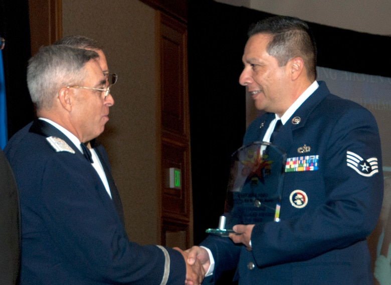Honor Guard Member Staff Sgt. Jose Toro, assigned to the 162nd Fighter Wing, accepts words of congratulations for his award from Brig. Gen. Michael Colangelo, Arizona Air National Guard commander. (U.S. Air Force photo/Master Sgt. Dave Neve)