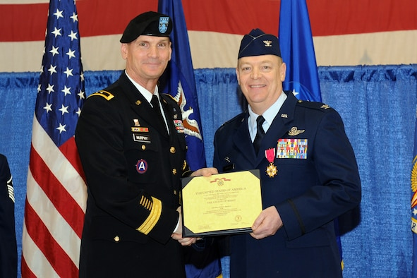Maj. Gen. Patrick Murphy (left), the Adjutant General of the State of New York, presents Col. Kevin Bradley, outgoing 174th Fighter Wing Commander, with the Legion of Merit medal for outstanding leadership.  Col Bradley relinquished command of the 174th Fighter Wing to Col. Greg Semmel during a cermenony held at Hancock Field Air National Guard Base on Sunday March 4, 2012. (New York Air National Guard photo by Staff Sgt. James N. Faso II/Released)