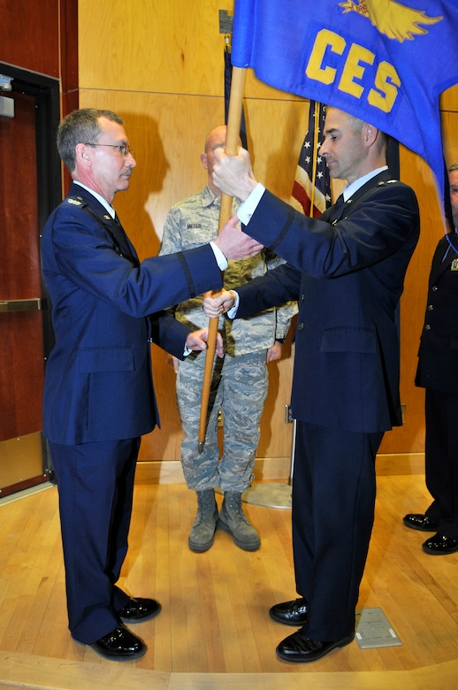 Col. Jack Wall, 151st Mission Support Group commander, accepts the 151st Civil Engineering Squadron guidon from Lt. Col. Anthony Faaborg as he relinquishes command of the 151st CES during the change of command ceremony at the Utah Air National Guard Base in Salt lake City, Utah, March 3. (U.S. Air Force Photo by Tech. Sgt. Jeremy Giacoletto-Stegall/Released)