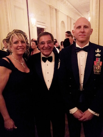 "Master Sgt. Kevin Bullivant, 151st Civil Engineer Squadron, and his girlfriend Kathy Blanchard pose with the U.S. Secretary of Defense Leon Panetta at a White House dinner hosted by President and Mrs. Obama on Feb. 29, 2012. More than 70 service members who served in Operation Iraqi Freedom and/or Operation New Dawn and families were recognized at the event entitled, ""A Nation's Gratitude Dinner.""  Bullivant was an explosive ordinance disposal specialist who received two Bronze Stars in Iraq, and was also submitted for a Purple Heart. Bullivant was one of two Air National Guard members recognized at the event.  (U.S. Air Force Courtesy Photo/Released)"