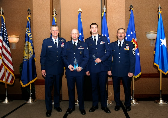 Oregon Air National Guard Commander Brig. General Steven Gregg stands (left to right) with Category I level award winners, Senior Airman Issac K. Martin and Airman First Class Craig Payne, along with Oregon State Command Chief Master Sgt. Mark Russell during the 18th Annual Oregon Air National Guard Awards Banquet, held in Portland, Ore., on February 25, 2012. (US Air Force Photograph by Tech. Sgt. John Hughel, 142nd Fighter Wing Public Affairs)(Released)
