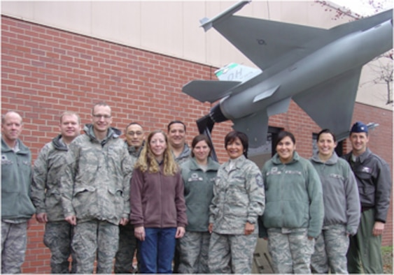 The 180th Fighter Wing has been selected as the first recipients of the Chuck Smith Environmental, Safety and Occupational Health Award. The 180th ESOH team will receive the award next month at the AF ESOH Symposium in Denver, Colo. (Pictured left to right back row: Lt. Col. Bill Antoszewski, Tech. Sgt. Joe Carter, Master Sgt. George Plasencio, Senior Master Sgt. Jim Dickman. Front row: Staff Sgt. Ben Laubender, Jennifer Lake, Tech. Sgt. Andrea Vollmer, Senior Master Sgt. Annie Menchaca-Bratton, SSgt Angela Delgado, Master Sgt. Ann McCormick, Col. Steve Nordhaus)