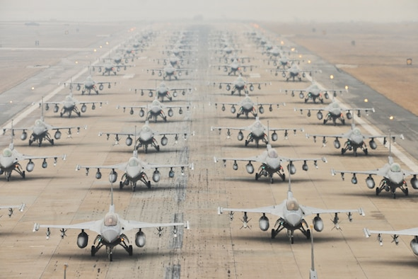 """F-16 Fighting Falcons from the 35th and 80th Fighter Squadrons of the 8th Fighter Wing, Kunsan Air Base, Republic of Korea; the 421st Expeditionary Fighter Squadron of the 388th FW at Hill Air Force Base, Utah; the 55th EFS from the 20th FW at Shaw AFB, S.C.; and from the 38th Fighter Group of the ROK Air Force, demonstrate an """"Elephant Walk"""" as they taxi down a runway during an exercise at Kunsan Air Base, Republic of Korea, March 2, 2012. The exercise showcased Kunsan AB aircrews' capability to quickly and safely prepare an aircraft for a wartime mission. (U.S. Air Force photo by Senior Airman Brittany Y. Auld/Released)"""