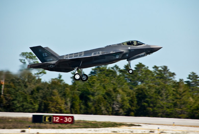 The F-35A Lightning II joint strike fighter lifts off for its first training sortie March 6 at Eglin Air Force Base, Fla.  It's the first flight of any 33rd Fighter Wing F-35 since their arrival to the base.  (U.S. Air Force photo/Samuel King Jr.)