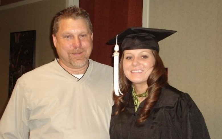Airman 1st Class Tabitha N. Haynes, Air Force District of Washington Public Affairs, and her dad Rod Haynes, in 2008 when she graduated from The Ohio State University, Columbus, Ohio.