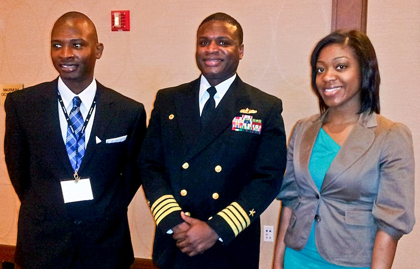 SSC Atlantic Commanding Officer Capt. Mark Glover is pictured with SSC Atlantic employees Brian Reese and Marquita Priester who were named 2012 Modern-Day Technology Leaders by the Black Engineer of the Year Award Science, Technology, Engineering and Mathematics organization. (Courtesy photo)