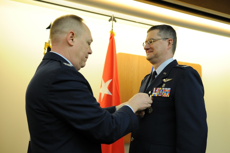 New York Air National Guard State Air Surgeon Col. Reid T. Muller (right) receives the Conspicuous Service Medal from Col. Kevin W. Bradley, 174th Fighter Wing Commander, during Col. Muller's retirement ceremony held at Hancock Field Air National Guard Base, Syracuse, NY on 4 March 2012.  The medal was awarded by Governor Andrew M. Cuomo to commemorate Col. Muller's long and distinguished career.  (New York Air National Guard photo by Tech. Sgt. Jeremy M. Call/Released)