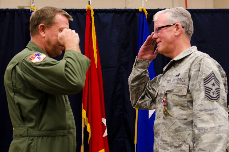 Missouri Air National Guard's Command Chief Master Sgt. William D. Phillips salutes Assistant Adjutant General Steven Cotter, Rosecrans Air National Guard base, St. Joseph, Mo., March 3, 2012. Chief Phillips has over 40 years of service in the Air National Guard and started out as a member, here, at the 139th Airlift Wing. (U.S. Air Force Photo by Senior Airman Kelsey Stuart)