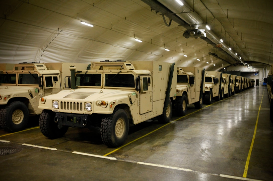 Humvees are stored inside the Frigaard Cave in central Norway. The cave is one of six caves that are part of the Marine Corps Prepositioning Program-Norway, which supports the equipping of Marine Expeditionary Brigade consisting of 15,000 Marines and with supplies for up to 30 days.  (U.S. Marine Corps photo by Lance Cpl. Marcin Platek)::r::::n::::r::::n::::r::::n::