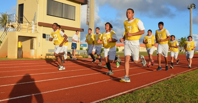 Reserve Officer Training Corps cadets for John F. Kennedy High School in Tumon, Guam, participate in a standardized Air Force physical fitness test conducted by 36th Force Support Squadron members Feb. 26 curing a base tour. As well as conducting the test, the 36 FSS members emphasized the importance of PT and stressed Andersen's 90 at 90 initiative, where Airmen are striving for a 90 percent on their PT tests.  (U.S. Air Force photo/Senior Airman Veronica McMahon)