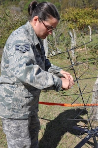 LA CEIBA, Honduras – Air Force Staff Sgt. Sharon Siciliano, Army Forces S6 data NCO, Soto Cano Air Base, Honduras, fixes an antenna array during a medical readiness and training exercise here March 7. Siciliano provided internet and radio capability ensuring members of the MEDRETE team could communicate within the team as well as relay information to Joint Task Force-Bravo. The MEDRETE team saw more than 300 people on the first day of the MEDRETE. The medical professionals treated illnesses including respiratory infections, skin infections, pneumonia, tuberculosis, diabetes and high blood pressure. (U.S.  Air Force photo/Capt. Candice Allen)