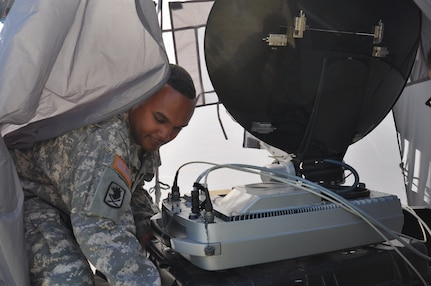 LA CEIBA, Honduras – Army Sgt. John Simon, Army Forces S6 NCOIC, Soto Cano Air Base, Honduras, moves the SWE-DISH, a tactical satellite communication system, during a medical readiness and training exercise here March 7. Simon provided internet and radio capability ensuring members of the MEDRETE team could communicate within the team as well as relay information to Joint Task Force-Bravo. (U.S. Air Force photo/Capt. Candice Allen)