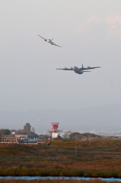 A C130J from the 146th Airlift Wing performs a MAFFS (Modular Airborn Firefighting Systems) water drop near Point Mugu during MAFFS recertification and training March 6, 2012. (AF photo by Senior Airman Nic Carzis)