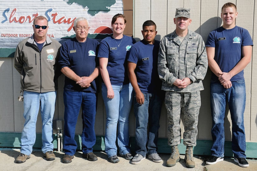 Left, Richard Hahn, Matt Vacher, Petty Officer 3rd Class Sharon Duncan, Petty Officer 3rd Class Juan Avelar, Col. Richard McComb and Petty Officer 3rd Class Chandler Mazure take a moment to pose for a photograph after McComb presented each of them with a command coin at Short Stay Navy Outdoor Recreation Area at Lake Moultrie in Moncks Corner, S.C., Mar. 7. The staff members and Sailors were directly involved with rescuing the lives of two elderly gentlemen whose boat overturned in Lake Moultrie near Short Stay Jan. 17. McComb is the Joint Base Charleston commander, Hahn is the Short Stay assistant manager, Vacher is the Short Stay sailing director, Duncan is an electronics technician assigned to Naval Nuclear Power Training Command, Avelar is a machinist's mate assigned to NNPTC and Mazure is a machinist's mate assigned to Nuclear Power Training Unit. A fourth Sailor, Petty Officer Justin Keene also assisted in the rescue but has already transferred to his next assignment at the Nuclear Power Training Unit in Ballston, Spa, N.Y. (U.S. Navy photo/Petty Officer 2nd Class Brannon Deugan)