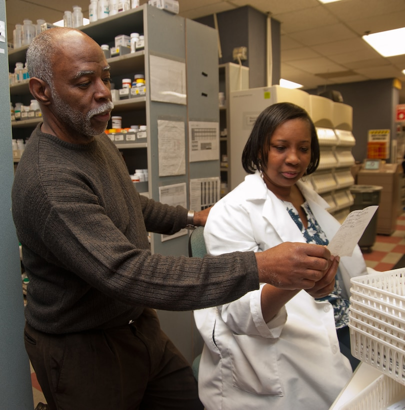 AiMartin Johnson, 779th Medical Support Squadron pharmacy technician, and Dr. Daleitha Stewart, 779 MDSS pharmacist, clarify a prescription dosage at the Andrews Satellite Pharmacy on March 6. (Photo/Bobby Jones)