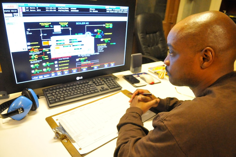 Ernest Moss, boiler plant operator, monitors boiler and steam output. (U. S. Air Force photo by Sue Sapp)