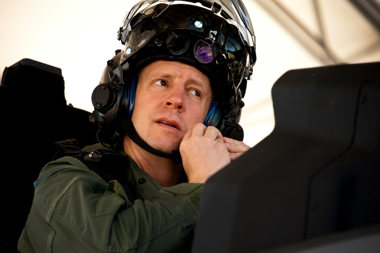 Lt. Col. Eric Smith, the 58th Fighter Squadron director of operations, secures his helmet from the cockpit of the F-35A Lightning II joint strike fighter prior to its first-ever training sortie March 6 at Eglin Air Force Base, Fla.  Smith is the first Air Force pilot qualified to fly the F-35.  (U.S. Air Force photo/Samuel King Jr.)