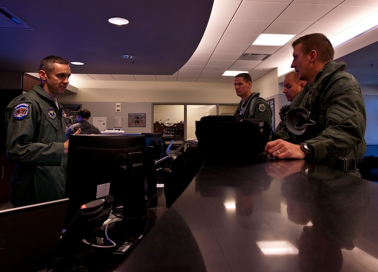 (Right to left) Lt. Col. Eric Smith, the first Air Force qualified F-35 pilot, Maj. Joseph Bachmann, the first Marine qualified F-35 pilot, and Lt. Col. Lee Kloos, the 58th Fighter Squadron commander, receive an operations brief from Lt. Col. Todd LaFortune before stepping out for the first-ever F-35A Lightning II joint strike fighter training sortie March 6 at Eglin Air Force Base, Fla.  (U.S. Air Force photo/Samuel King Jr.)