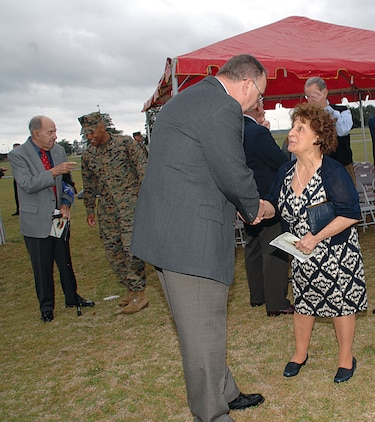 Kent Morrison, executive director, Marine Corps Logistics Base Albany, talks with Mary Deiter, the wife of Karl Deiter, who was the first Marine stationed in Albany.