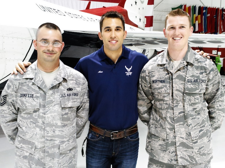 Aric Almirola, driver of the Air Force-sponsored No. 43 car, greets two new members of the U.S. Air Force Thunderbirds Air Demonstration Squadron in the Thunderbirds hangar March 8, 2012. Almirola was in town to compete in the Kobalt Tools 400 NASCAR race at Las Vegas Motor Speedway March 11.