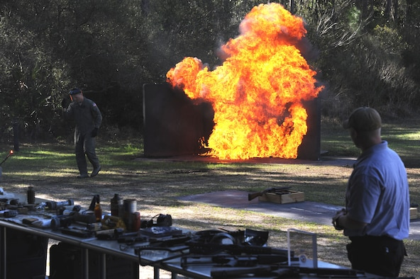 Lt. Col. Dan Wilson, chief of the irregular warfare division of the United States Air Force Special Operations School, throws a Molotov cocktail at a test site as part of a demonstration at Hurlburt Field, Fla. Mar. 6, 2012. The demonstration is part of the USAFSOS Dynamics of International Terrorism course, a weeklong course that introduces students to terrorist threats posed worldwide and corresponding antiterrorism measures. (U.S. Air Force photo/Rachel Arroyo)