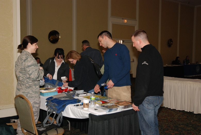 1st Lt. Lindsay Sorce hands out informational pamphlets and other materials at the Family Readiness table as part of the 107th's Yellow Ribbon Reintegration Program in Rochester, NY. (U.S. Air Force Photo/Capt. Elaine Nowak)