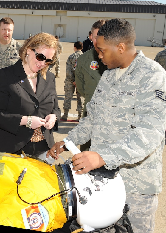 Staff Sgt. Kentonis McGee, 9th Physiological Support Squadronsuit technician, explains to Under Secretary of the Air Force Erin Conaton how U-2 Dragon Lady pilots drink and eat during long flights. Conaton visited Beale Air Force Base, Calif., March 7, 2012, to learn more about the base's continuing intelligence, surveillance and reconnaissance mission. (U.S. Air Force photo/John Schwab/Released)