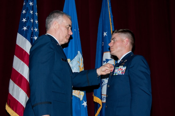 Lt. Col. Kenneth Kleid, acting commander of the Oklahoma Air National Guard's 146th Air Support Operations Squadron, presents the Bronze Star Medal to 2nd Lt. Christopher Schutte of Las Vegas, Nev., an air liaison officer for the 146th ASOS, at Officer Training School March 1. Schutte, who earned his commission as a second lieutenant in the Oklahoma Air National Guard from the Academy of Military Science March 2 , is the first OTS student to receive a Bronze Star Medal during his commissioning training. Schutte earned the medal for actions he took while serving as the enlisted battalion air liaison officer and lead joint terminal attack controller in support of the 1st Battalion, 179th Regiment, 45th Infantry Brigade Combat Team. He and his team engaged in ground combat in the Laghman and Nuristan Provinces, Regional Command-East, Afghanistan, during Operation Enduring Freedom from July 13 to Dec. 12, 2011. (Air Force photo/Melanie Rodgers Cox)