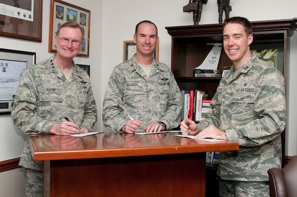 From left, Lt. Gen. David Fadok, commander and president of the Air University, Col. Brian Killough, commander of the 42nd Air Base Wing, and Capt. Charles Stallings of the 42nd Medical Group, the Air Force Assistance Fund coordinator, sign pledges in Fadok's office Tuesday. The AFAF campaign on Maxwell-Gunter runs until April 13. AFAF supports four charities whose benefits are only available to those in the Air Force family – the Air Force Aid Society, Air Force Village, Air Force Enlisted Village and the Gen. and Mrs. Curtis E. LeMay Foundation. See your AFAF unit representative to contribute. (Air Force photo/Sarah Byrd)