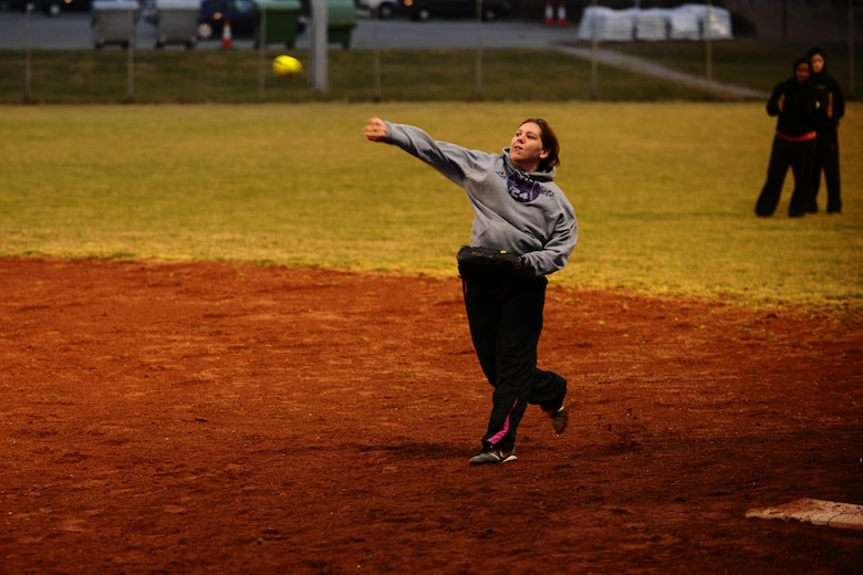 SPANGDAHLEM AIR BASE, Germany – Ali Guidry, 52nd Force Support Squadron, throws a softball to a teammate during Spangdahlem Lady Sabers varsity softball team tryouts at varsity field 1 here March 7. The softball team held tryouts until March 9. The varsity softball team competes in tournaments throughout Europe playing against other Air Force, Army and Navy teams. (U.S. Air Force photo by Airman 1st Class Matthew B. Fredericks/Released)