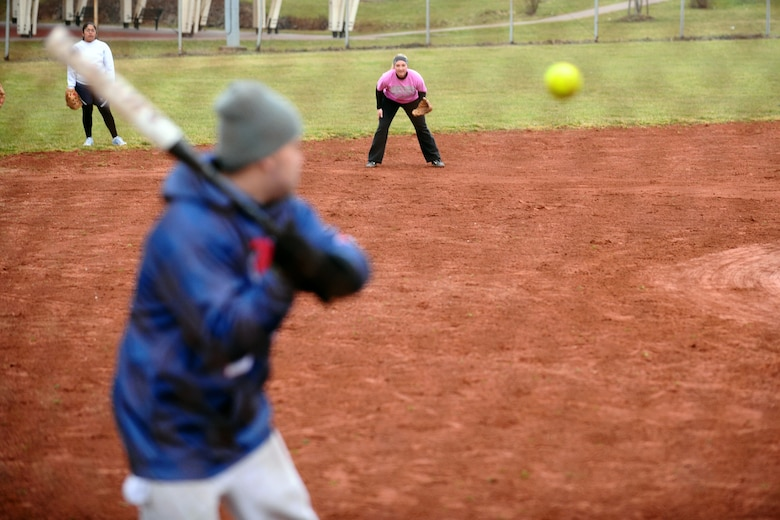 SPANGDAHLEM AIR BASE, Germany – Kristen Gieras prepares to field a ball hit by Spangdahlem Sabers varsity softball team member Jason De La Vega, 52nd Component Maintenance Squadron, during Spangdahlem Lady Sabers varsity softball team tryouts at varsity field 1 here March 7. The softball team held tryouts until March 9. The varsity softball team competes in tournaments throughout Europe playing against other Air Force, Army and Navy teams. (U.S. Air Force photo by Airman 1st Class Matthew B. Fredericks/Released)