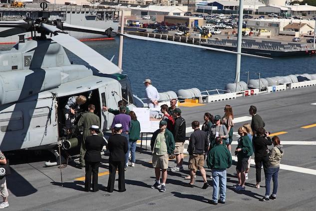 Members of the Carter Center learn about the UH-1Y helicopter during a visit to the USS Peleliu Mar. 10. The visitors flew from all parts of the U.S. for the Carter Center Winter Weekend and were able to see firsthand the USS Peleliu and learn about the capabilities of the 15th Marine Expeditionary Unit.