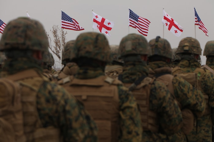 Marines assigned to the Black Sea Rotational Force observe the national anthems of the United States of America and Georgia during the opening ceremony of Operation Agile Spirit on Vaziani Training Area in Georgia, March 12. The combined operation is designed.