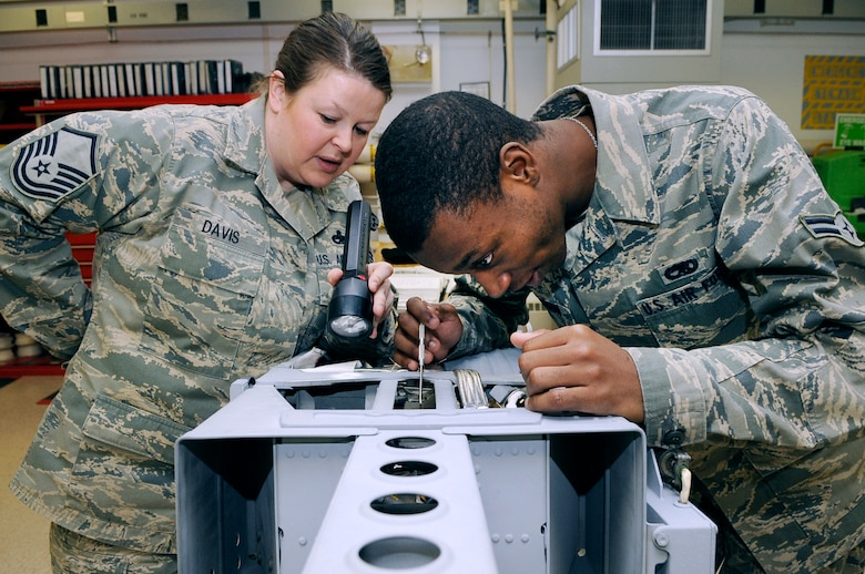 U.S. Air Force Master Sgt. Becky Davis, 354th Maintenance Squadron egress section chief, and Airman 1st Class William Harrison, 354th Maintenance Squadron egress apprentice, repair deficiencies on an F-16 Fighting Falcon Advance Concept Ejection Seat II March 9, 2012, Eielson Air Force Base, Alaska. Once clear of an aircraft, the ACES II is capable of automatically sensing egress conditions and mortar-deploying its main chute in less than 2 seconds. (U.S. Air Force photo/Staff Sgt. Jim Araos)