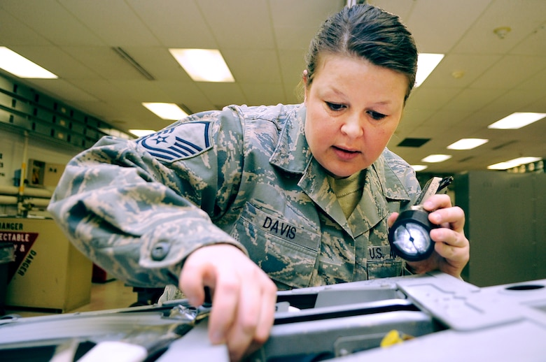 U.S. Air Force Master Sgt. Becky Davis, 354th Maintenance Squadron egress section chief, inspects an F-16 Fighting Falcon Advance Concept Ejection Seat II March 9, 2012, Eielson Air Force Base, Alaska. Davis will inspect for cracks, contamination, corrosion and the correct routing of hoses to ensure to proper function in the event of an in-flight emergency. (U.S. Air Force photo/Staff Sgt. Jim Araos)