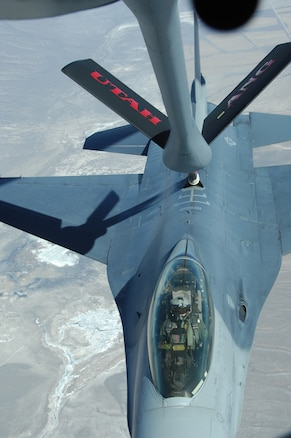 A Utah Air National Guard KC-135 refuels an F-16 from the 419th Fighter Wing over the Utah desert on March 8.  The KC-135 from the 151st Air Refueling Wing refueled seven Utah fighter jets during their training mission.  U.S. Air Force photo by Maj. Krista DeAngelis. (Released)